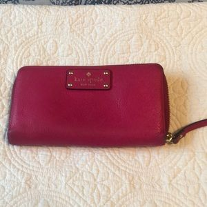 Kate Spade pink leather zipper wallet.
